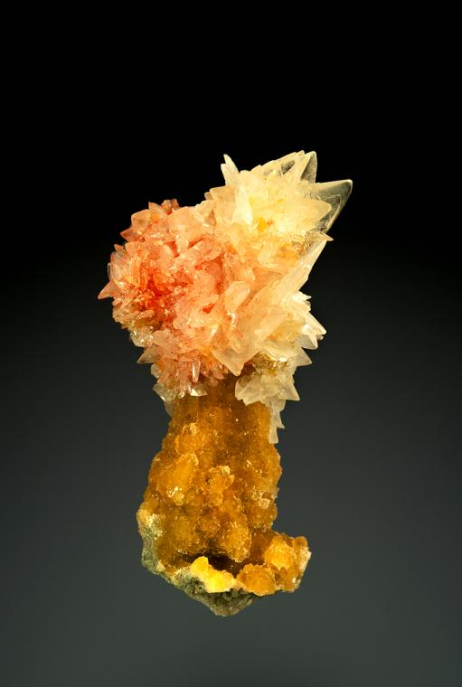 COLEMANITE with REALGAR on CALCITE
