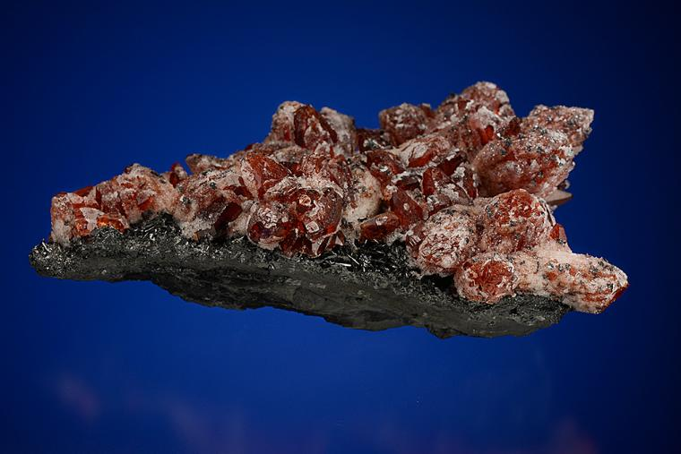 RHODOCHROSITE with QUARTZ on MANGANITE